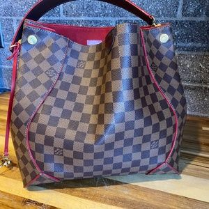 Authentic Louis Vuitton Cassia handbag